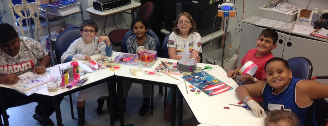 Happy children doing colouring and craft at Liverpool Hospital School